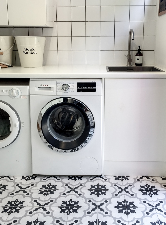 Scandinavian laundry. Black and white tiles.